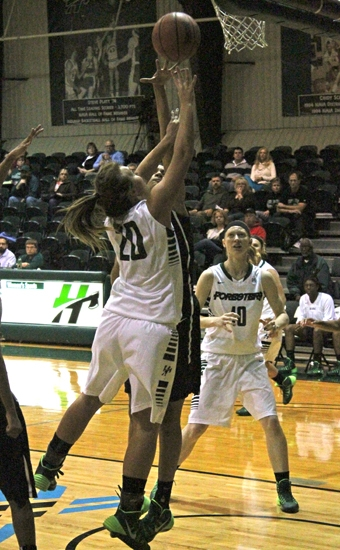 Huntington University sophomore Amelia Recker goes hard to the hoop against a Wilberforce University defender on Friday night, Nov. 15, at Platt Arena.