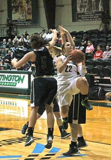 Huntington University guard Pazia Speed splits a pair of Mount Vernon Nazarene defender on the way to the hoop on Saturday, Dec. 7, at Platt Arena.