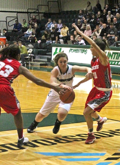 Huntington University guard Kelsey Hubble attempts to split a pair of Indiana Wesleyan defenders during Crossroads League Tournament semifinal action on Friday night, Feb. 28, at Platt Arena.