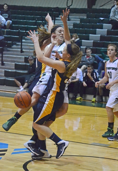 Huntington University guard Courtney Baker takes a hard foul in action against visiting Spring Arbor University on Wednesday, Dec. 4. HU won 72-49.