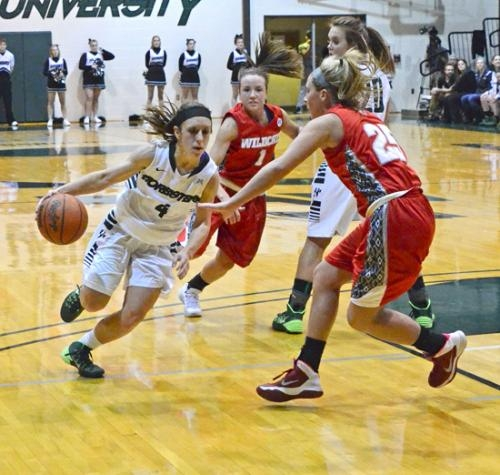 Huntington University point guard Courtney Baker charges past the Indiana Wesleyan defense  on Wednesday, Feb. 5, at Platt Arena in the Foresters 51-49 victory.