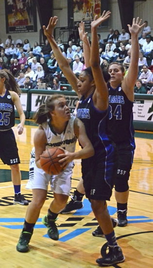 Huntington University guard Pazia Speed looks for an opening against a pair of Saint Francis defenders on Wednesday night, Feb. 19, at Platt Arena. The Foresters fell, 62-53.