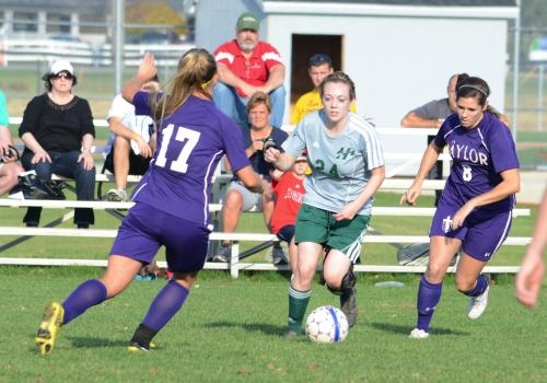 Huntington University midfielder Sam Cubic (center) controls the ball against visiting Taylor University on Wednesday, Oct. 24, at Huntington North High School. The Foresters lost 1-0 in overtime.