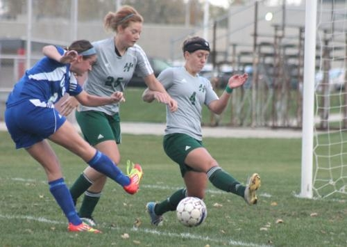 Huntington University women's soccer team players (from left) Jessica Krause and Courtney Baker attempt to block a shot by a Univeristy of Saint Francis player during action on Thursday, Oct. 18, at Huntington North High School.