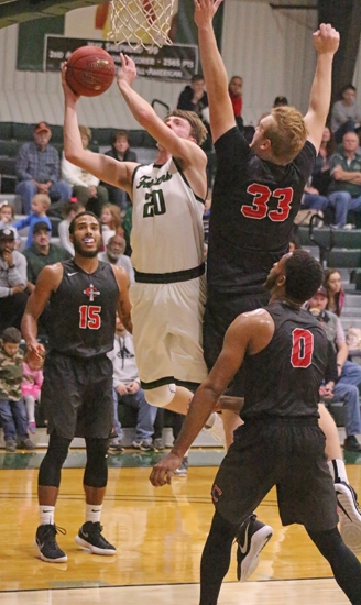 Mason Coverstone (left), a junior on the Huntington University men's basketball team, drives to the hoop during a game against visiting Concordia University on Saturday, Nov. 4. Coverstone tallied 11 points for the Foresters, who lost, 91-76.
