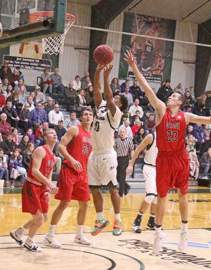 Huntington University point guard Mike Bush goes to the rim in front of several Grace defenders in the Foresters' 88-80 win last night, Tuesday, Jan. 30, at Platt Arena.