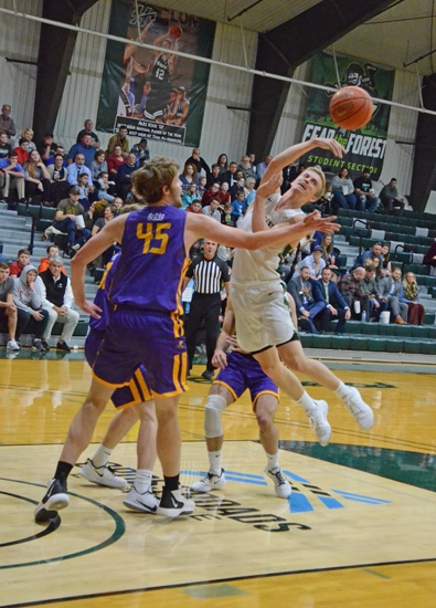 Huntington University guard Konner Platt does some mid-air maneuvering to get a pass out to the wing in action Saturday, Nov. 9, in the championship game of the Ness Bros. Hall of Fame Classic at Platt Arena on Saturday, Nov. 9.