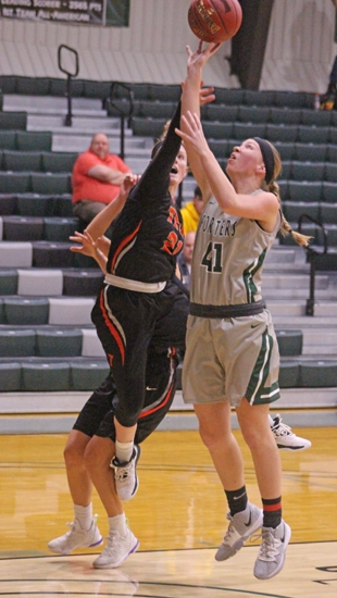 Huntington University's Cindy In't Groen puts up a short shot against an Indiana Teach defender on Tuesday evening, Oct. 29, at Platt Arena, in the Foresters' 79-77 overtime win.