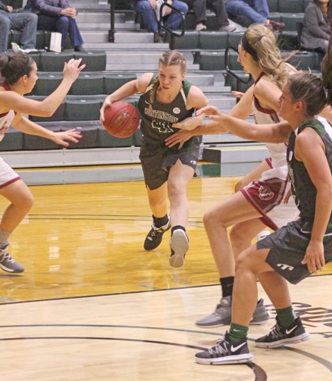 Cindy In't Groen (middle), a sophomore on the Huntington University women's basketball team, dashes through a hole in the defense during a game against visiting Aquinas College on Saturday, Nov. 4. The Foresters won, 54-43.