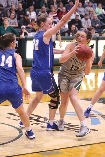 Pictured here in a game from this past season, Sarah Fryman (right), a senior on the Huntington University women's basketball team, has been named the Crossroads League Player of the Year.