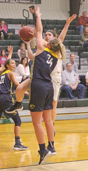 Huntington University guard Maddie Richer is all concentration as she shoots over a Spring Arbor University defender in action Saturday afternoon, Jan. 27, at Platt Arena. The Foresters won, 74-57.