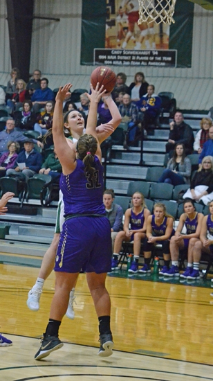 Huntington University forward Sarah Fryman puts up a left-handed shot in close to the basket against a Taylor defender on Wednesday night, Dec. 3. The Foresters lost, 65-61.