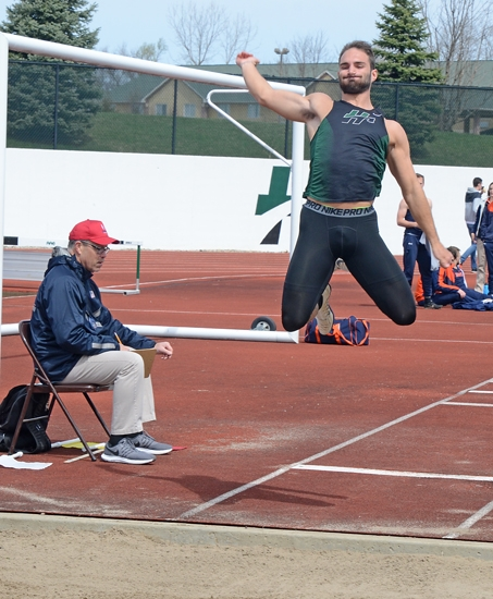 Huntington University long jumper Adam Woods maneuvers in mid-air as he tries for more distance during the Huntington University Invitational at King Stadium on Saturday, April 13. HU won the invitational.