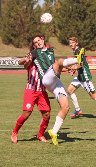 Miguel de Sousa, a junior on the Huntington University men's soccer team, tangles with a defender from visiting Indiana Wesleyan University during the first half of a game on Saturday, Sept. 30. The Foresters and Wildcats played to a 2-2 tie.