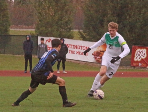 Huntington University midfielder Luke Unger tries to maneuver past Saint Francis player Ethan Vigario in Crossroads League Tournament action on Saturday, Nov. 2, at King Stadium. Unger wound up with a goal later on as the Foresters won 4-1.