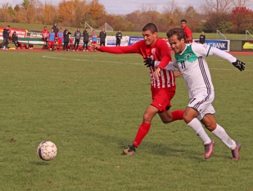 Huntington University soccer player Matheus Louzada (right) and Indiana Wesleyan University defender Gabe Quesada get a little physical with each other as they purse the ball during a Crossroads League Tournament semifinal game Saturday, Nov. 3, at King Stadium. The Foresters won, 3-1, to advance to the championship game next Saturday.