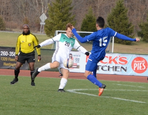 In what almost looks like a face-off, Noah Fleming of Huntington University and Matheus Santiago of Bethel both take a swipe at the soccer ball in the semifinal match of the Crossroads League Men's Soccer Tournmament on Saturday, Nov. 9, at King Stadium. Fleming later scored the game-winner.