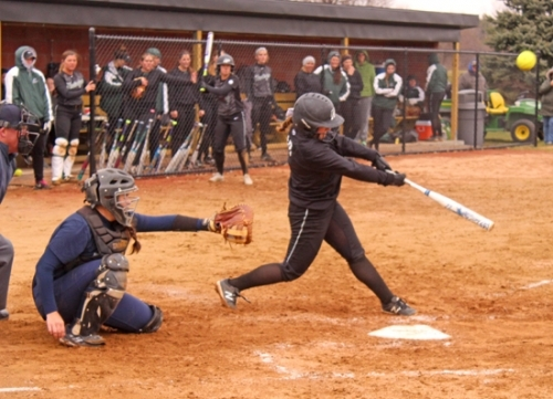 Huntington University's Marty Harris drives the ball against visiting Mount Vernon Nazarene University on Friday, April 6. The Foresters won on a seventh-inning walk-off homer by Ashley Brown.