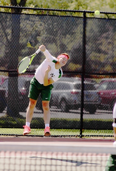 Huntington University men's tennis player Mariano Echevarria unleashes a big serve during his match at first doubles with Ignacio Poncio versus Danny Mayotte and Logan Gauthier, of visiting Mount Vernon Nazarene University, on Saturday, Sept. 9. The Foresters routed the Cougars, 9-0.