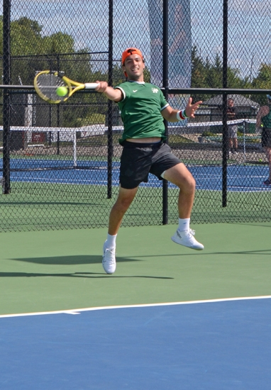 Huntington University's second singles player, Rodrigo Manzo, returns a shot against his University of Saint Francis opponent on Saturday morning, Sept. 7. HU swept the match, 7-0.