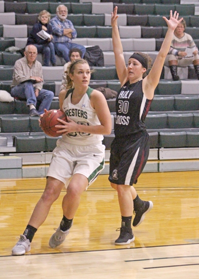 Casey Morton (left), a senior on the Huntington University women's basketball team, maneuvers around Holy Cross defender Alex Forster during a game on Tuesday, Nov. 6, at Platt Arena. The Foresters defeated the Saints, 78-68.