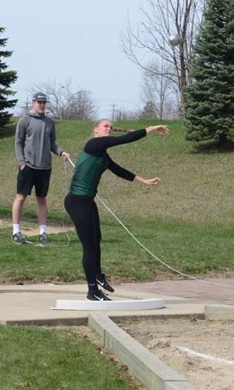 Huntington University's Brooke Saylor releases the shot put during the Huntington University Invitational on Saturday, April 13, at King Stadium. Saylor threw a personal-best 11.58 meters to place second in the event.