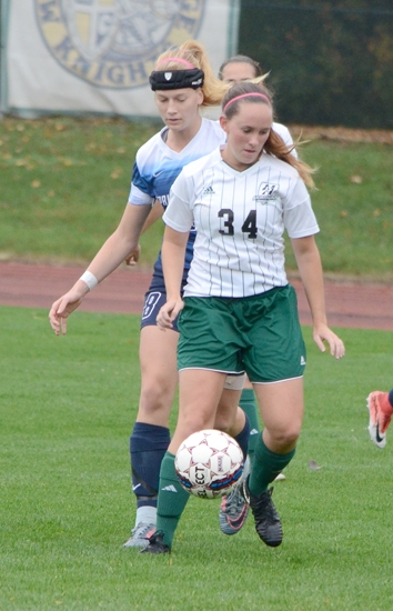 Huntington University's Katherine Highstead controls the ball despite the efforts of a Spring Arbor player in action Wednesday evening, Oct. 11, at King Stadium. The Foresters lost 2-0.