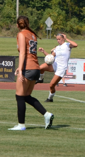 Huntington University women's soccer player Avery Giguere tries to control a high ball during play Wednesday afternoon, Sept. 11, against visiting Lourdes. Lourdes won, 1-0.