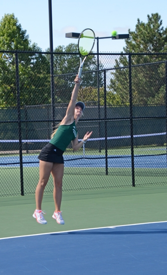 Huntington University second singles player Charlotte Solli grabs some air as she serves to her Saint Francis opponent on Saturday morning in the first of two matches on the day for the Foresters. They swept USF but get swept later by Indiana Tech.