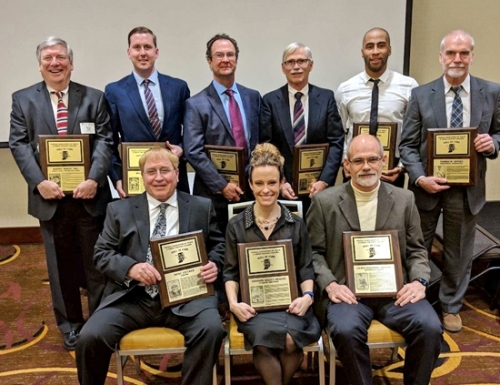 Garrett Davenport (seated, third from left) represents his daughter, Lauren Johnson, at the 2018 Indiana Association of Track and Cross Country Coaches (IATCCC) Hall of Fame induction ceremony on Feb. 2 at the Sheraton Hotel at Keystone Crossing, in Indianapolis. Johnson, a professional runner from Huntington, was unable to attend the ceremony as she was preparing for a race in New York, NY. Hall of fame inductees were (seated from left) Ricke Stucker, Shannon Kelley Dragoo and Davenport representing Johnson; and (standing from left) Marty Hill, Michael Fout, Allen Dunn representing Fred Seward, Rudy Skorupa, Bryce Brown and Thomas D. Haynes representing Thomas M. Haynes.