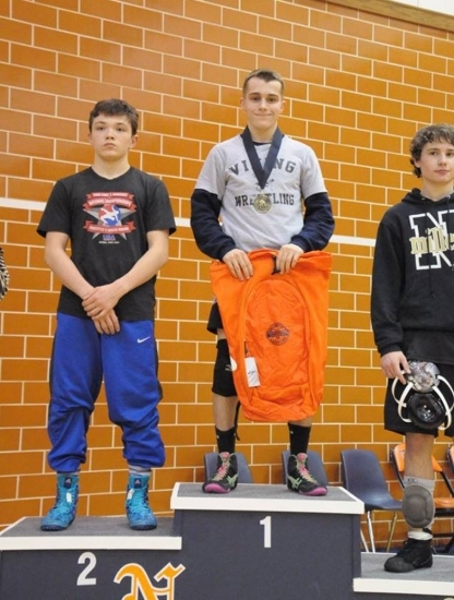 Huntington North's 126-pound wrestler Jacob Hall (center) was the champion in his weight class in the individual tournament portion of the North Montgomery Holiday Wrestling Tournament on Saturday, Dec. 30.