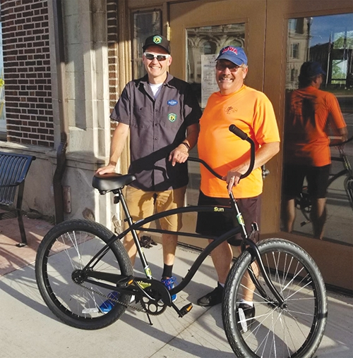 Chris Bucher (left) from Trailhouse Village Bicycles in Winona Lake, and Jim Lewis, HARTA president, show off the bicycle that Trailhouse Village Bicycles donated, which will be presented to the 2019 Adult division winner. Walmart is donating a gift card to the winner of the Youth/Children division that can be used for a bicycle purchase.