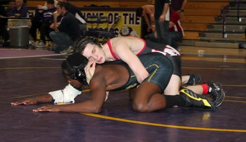 Huntington North's Ian Hiers (top) holds on to Snider's Jaisean Kimbrough in the first round of the varsity wrestling team's stop at the New Haven Wrestling Sectional on Saturday, Jan. 26. Hiers finished fourth in his weight class to advance to regionals.