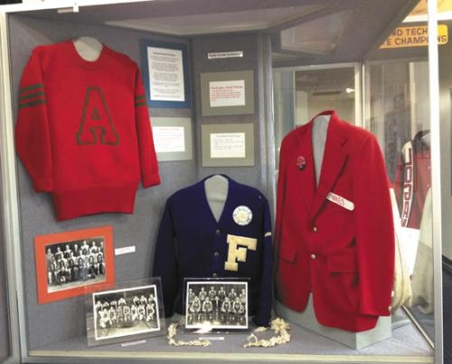 A red Huntington North High School blazer (right) is on display in a new exhibit chronicling the proud basketball tradition of the North Central Conference at the Indiana Basketball Hall of Fame in New Castle.