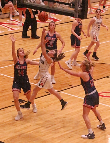 Huntington North's Reece Colcesser scores and gets fouled in action Friday night against Bellmont at North Arena. The Lady Vikes lost, 58-36.