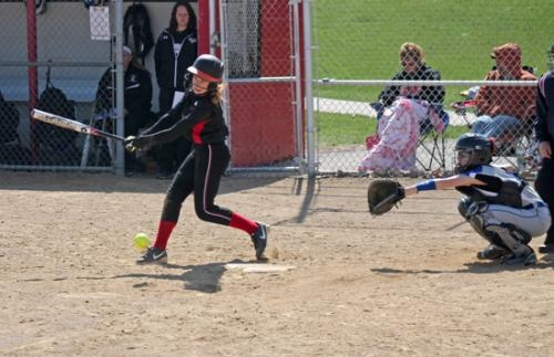 Huntington North hitter Jordyn Poulson gets a hit at the HNHS JV Invitational Softball Tournament on Saturday, Apil 19.