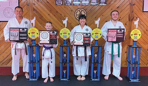 Members of Genbu-Kai Karate of Indiana in Huntington celebrate their scores from the recent Back to School Brawl Tournament. Pictured are (from left) Andy Norman, Mason Payton, Sensei Dawn Anderson and Nathan Mygrant. Not pictured are Alec Ellsworth and Kevin McGregor.