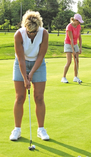 Michelle Darley practices her putting on the putting green at Clear Creek Golf Course. The Huntington Parks & Recreation Department and Clear Creek have teamed up to provide golf lessons to ladies age 18 and up this summer.