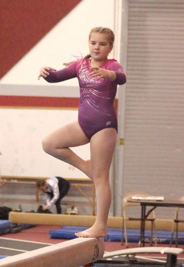 Jersey Hacker, a Level 3 gymnast with Huntington Gymnastic Academy, competes on balance beam during the Turkey Tumble meet, conducted by the academy on Saturday, Nov. 11, in the Huntington North High School Fieldhouse. Hacker captured first place on beam.