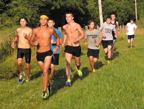 Participants in the MIB Challenge make their way around the course on Saturday, Aug. 3. The event, sponsored by Huntington North High School's Men In Black runners, was held at Huntington University's cross country course.