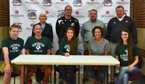 New Albany soccer player Morgan Miller (third from left) recently signed a letter of intent to play soccer at Huntington University starting in 2015.