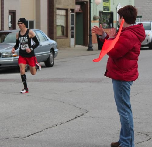 Brad Prather (left), of Roanoke, gets a hand from a race worker as he comes in second overall and first in the men's 36-49 division of the Discover Roanoke 10K race on Saturday, April 20.