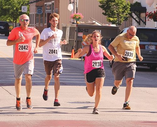 As Jeff Anderson and Steve Anderson (first and fourth from left, respectively) close in on the finish line during the 5K portion of the Discover Roanoke run, Chandler Neal (second from left) and Hollyn Anderson, who finished the race earlier, join them in a show of support. The event, held Saturday, June 6, in Roanoke, was originally scheduled for April 18, but was postponed due to the COVID-19 pandemic.