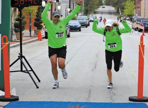 Robert and Dawn Fontaine celebrate their finish in last year's DiscoverRoanoke 10K run. The event, which also includes a 5K and one-mile run or walk, returns for its third year on April 20.