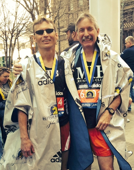 Bradley Prather, of Roanoke (left) and Dan Meyer, of Huntington, celebrate after crossing the finish line at the 2014 Boston Marathon.