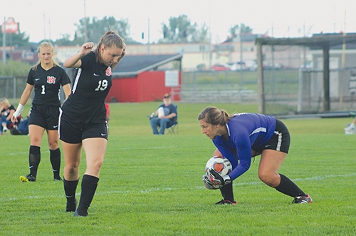 Taking control of the ball after a missed goal attempt by Bellmont is Huntington North High School keeper Maddie Husband. Also featured are HNHS teammates (from left) Julia Baker and Alexis Weaver. The Lady Vikings faced off against Bellmont on Tuesday, Sept. 8.