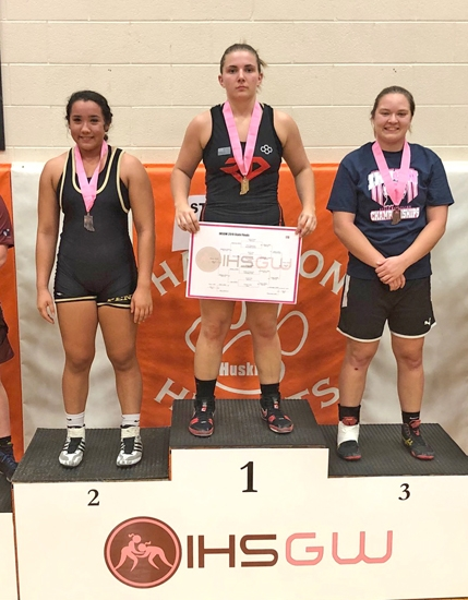 Amaya Sunderman (right), a Huntington North High School senior, placed third in the 170-pound weight class at the Indiana High School Girls' Wrestling State Finals on Jan. 11 at Hamilton Heights High School, in Arcadia. Pictured with Sunderman are the 170 champion, Jessica Moore (middle), of Richmond, and the runner-up, Amanda Feder, of Penn.