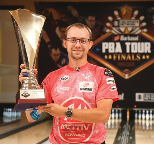 Huntington native EJ Tackett holds the championship trophy he won at the Barbasol PBA Tour Finals on Sunday, July 21, at Red Rock Lanes, in Las Vegas, NV. He won the tournament with a 2-1 victory over Jakob Butturff in the title match.