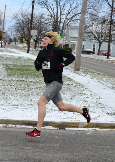Sean Lewis, of Huntington, heads down Home Street toward the finish line during the Pthfinder Kids Kampus Turkey Trot on Thursday, Nov. 28. Lewis placed third to lead all Huntington County runners..