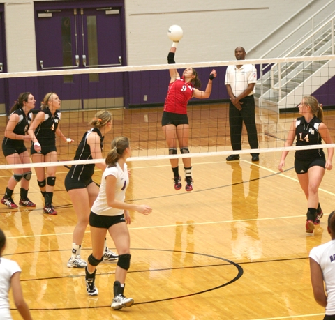 Lady Viking defensive specialist Morgan Broderick knocks a free ball back over the net during regional volleyball action against Muncie Central on Saturday, Oct. 31.